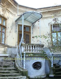 Little Paris type doorway with glass awning and Fotainebleau allegory staircase, Cotroceni area, Bucharest Marquise, Wrought Iron Decor, Little Paris, Religious Architecture, Beautiful Streets, Iron Doors, Roof Design, Bucharest, Source Of Inspiration
