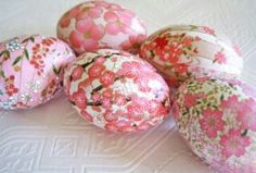 These are so pretty! Polystyrene eggs covered in paper or fabric. Similar colours but different patterns.