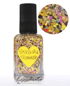 Lynnderella Limited Edition—Sriracha Scramble has in a clear multi-shimmered base with assorted matte yellows, black, white, neon pink, almost-neon red, holographic shards and rainbow dust.