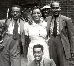 Ben Webster, Billie Holiday, Johnny Russell - in the back an unidentified guitarist, Harlem, 1935.