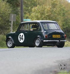Classic mini in racing green with side door number decal