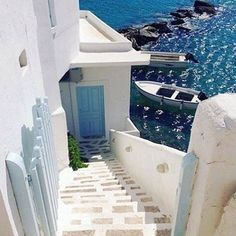 Traditional Cycladic stairs near the sea , at Sikinos island (Σίκινος) - Greece . Very peaceful and small island with a few beaches and hiking paths to explore ! Mykonos, Santorini Greece, Santorini Island, Cyclades Islands, Beautiful World, Beautiful Places, Places To Travel, Places To Visit, Greek Isles