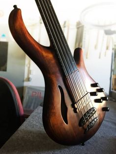 Mayones Patriot 5 Fretless Piezo Maurizio Rolli Signature Bass, Antique Brown Oiled finish, hand-selected Spruce top, Profiled Flamed Maple back & Wenge middle, Neck-thru-body construction, Semi-hollow body (2 connected tone chambers) with F-hole, 9-ply Maple/Mahogany neck section, Extended Ebony Fingerboard