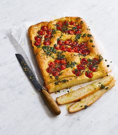 Light and fluffy focaccia is one of Italy's greatest recipes. This one contains extra juicy bursts of ripe vine tomatoes and zingy fresh pesto.