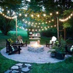 A DIY firepit and circular brick patio make the perfect outdoor entertaining spot.