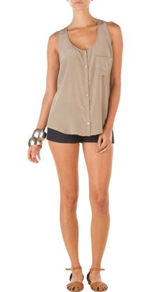"""Siri - Sand:    -  100% Silk.  -  Slouchy fit with tailored details.   Racer back.   Front left pocket.  6 button closure.   1 1/2"""" strap width."""