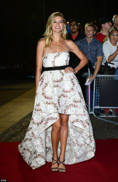 Red carpet glamour: The fairytale inspired number was completed with a black sash cinching in her tiny waist