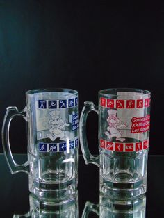 Olympic Games XXIII Beer Steins, 1984 Los Angeles Olympics Tankards, Sam the L.A. Olympic Eagle Mascot Mugs by 777VintageStreet on Etsy https://www.etsy.com/listing/287331167/olympic-games-xxiii-beer-steins-1984-los