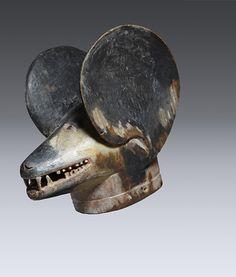 Helmet Mask (lipico), Makonde Wood, pigment, 38.1cm Private collection