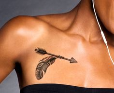 Woman with Arrow Tattoo with Leaf on Chest