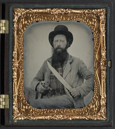 Private Thomas F. Bates, of D Company, 6th Texas Infantry Regiment on guard with his Bowie knife and pocket revolver.