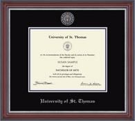 University of St. Thomas Diploma Frame - Features a custom-minted medallion of your school seal with color enamel accents recessed into silver embossed double black and purple museum-quality matting. It is shown in our Kensington Silver moulding with a cherry satin finish and silver beaded detail.