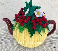 A personal favorite from my Etsy shop https://www.etsy.com/listing/600686765/crochet-tea-cozy-yellow-tea-cover-red