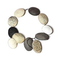 Myung Urso. Neckpiece: Morphe, 2015. Cotton, thread, sterling silver, lacquer. 27 x 27 x 2.5cm.