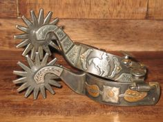 """Handmade pair of Mike Richardson's stamped """"Richardson 613"""". Double mounted with Byers flower on one side and Bronc rider on the other. $850.00"""