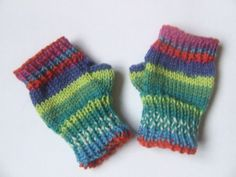 Fingerless mittens - boys girls unisex wristwarmers - age 2, 3, 4 years - green blue red multicoloured - hand knitted. £6.50, via Etsy.