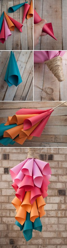 DIY Paper Cone Centerpiece - minus the rope at the top. There has got to be a cuter way to hang it.