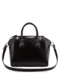 "Givenchy shiny calfskin satchel bag with shiny palladium hardware. Rolled tote handles, 3.5"" drop. Flat shoulder strap, 13.4"" drop. Extended zip top closure. Envelope flap detail with metal logo lette"