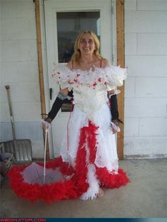 Ugliest Wedding dress ever. Like, who thought this was a good idea? It looks like a vomit of feather boas.