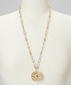Take a look at this Gold & Clear Globe Pendant Necklace by Marlyn Schiff on #zulily today!