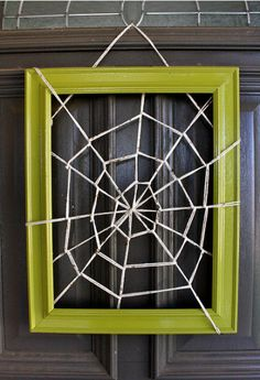 Cool #halloween spider web with string around a picture frame