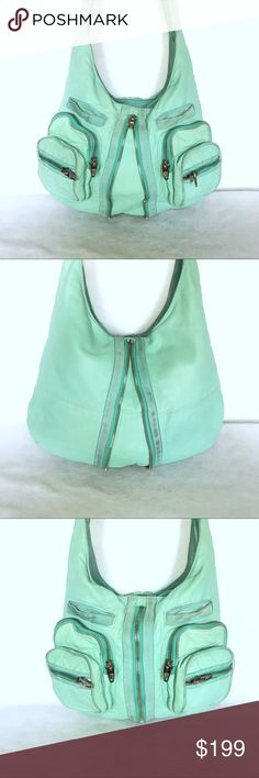 "Alexander Wang Aqua Leather Donna Hobo Crossbody 💚 Can be worn as a hobo or crossbody!  Outside shows general wear for this type of leather.  Inside is spotless.  - Aqua lambskin leather w/ suede trim. - Tied shoulder strap. - 4 zip front pockets, 2 front pouch pockets. - Center zip to expand sides. - Inside zip pocket. - Top zip closure.  L: 16"" H: 13"" D: 3.5"" Strap Drop: 19""   📦 All of my jewelry & bags are carefully wrapped & shipped in boxes to ensure safe delivery. No mail bags or…"