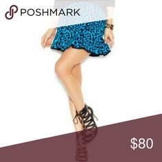 "Guess Animal Print Skirt Color bad boy blue Pull on, elastic waist with zipper Approx measurements Total length 18"" Waist across 14""  Hips across 15"" 58% Rayon, 42% nylon Guess Skirts"