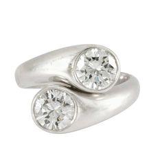 Platinum and Diamond Crossover Ring   2 round diamonds ap. 2.20 cts., ap. 8.6 dwt.