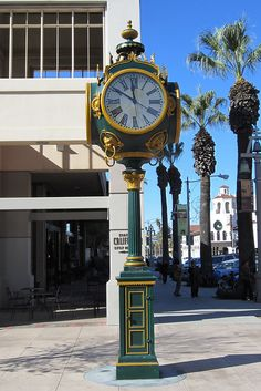 This is the Seth Thomas four-dial post street clock currently installed and operating at the corner of Mission Inn Avenue and Main Street in Riverside, California.  It was originally manufactured and installed in Riverside in 1904.