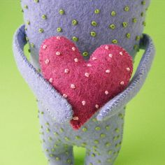 Make a sweet felt Oddball holding a sweet (and somewhat warty) felt heart.