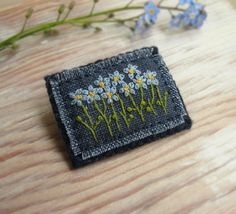 (inspiration) https://www.etsy.com/listing/188844229/forget-me-not-hand-embroidered-brooch