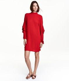 Check this out! Knee-length dress in crêped viscose. Small stand-up collar, opening at back of neck with covered buttons, and long raglan sleeves with flounces. Unlined. - Visit hm.com to see more.