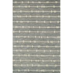 Complement a contemporary ensemble or bring eye-catching appeal to the entryway with this wool rug, featuring a barbed stripe pattern in gray.