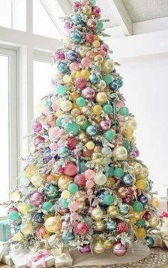 White Christmas tree with pastel ornaments. Expecting a baby near Christmas time? This tree would make a beautiful focal point for your shower decor and a pretty tree for baby's arrival. Kids love this fun and colourful tree! Silver Christmas, Noel Christmas, All Things Christmas, Christmas Lights, Christmas 2019, Christmas Cactus, Homemade Christmas, Vintage Christmas, Christmas Icons