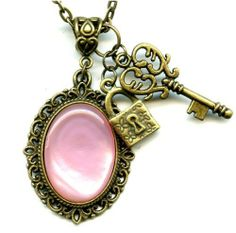 Brass Pendant Necklace Pink Mother of Pearl with Lock and Key Vintage Style Antiqued Bronze Moon Pixie. $19.50. Pink Mother of Pearl. Made in the USA. Vintage Style. Handmade. Brass