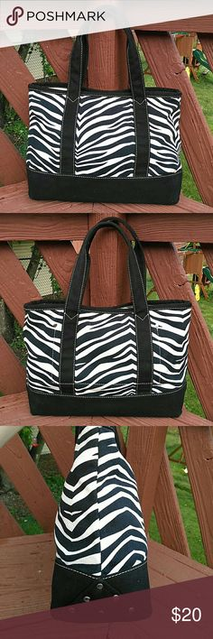 "J. Crew Black White Zebra Cotton Tote J. Crew cotton canvas black and ivory zebra print tote. Measures 14"" L x 10 1/2"" H x 5"" D with 8"" shoulder strap drop. Silver stud detailing,  open top for easy access, interior slip pocket. Great condition- minor interior spotting J. Crew Bags Totes"