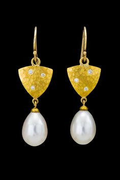 Drop shape pearl earrings in 24k and 18k gold. The hammered triangular shape is set with diamonds. Designed and made by Tom Wilson