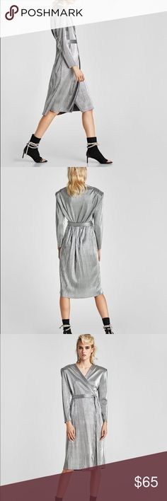 NWT Zara Metallic Silver Pleated Wrap Dress Zara Silver Pleated Dress  Size M - UK 10  Sarong-style Wrap dress with a plunging V-neckline, long sleeves  and pronounced shoulders with shoulder pads.  COMPOSITION OUTER SHELL: 100% polyester Zara Dresses Long Sleeve