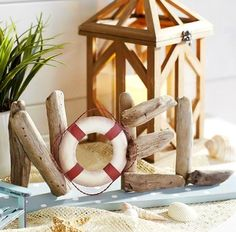 Driftwood Christmas (Noel) Sign with Life Preserver Ring: http://www.completely-coastal.com/2015/11/sea-inspired-coastal-christmas-collections.html