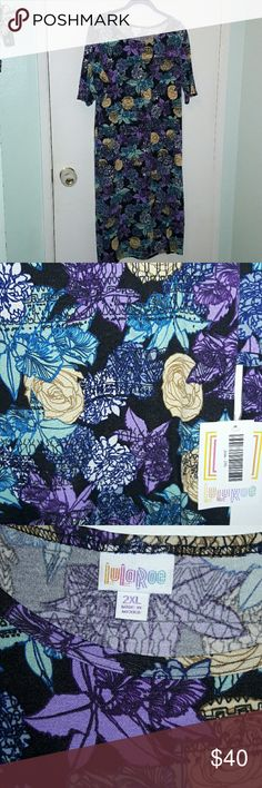 👉 🆕 LULAROE JULIA DRESS 👗 Lularoe Julia Dress featuring beautiful floral print. Yellow roses, shades of blues and purples, with pops of white. Print has a sketchlike look to it. The Julia dress can go from dressy to casual and worn fitted or slightly looser, depending on your comfort level. The Julia dress can be folded under to create a tunic style top, bunched up at the waist to create flattering ruching or a number of other ways. Pairs well with a vest or cardigan and is super cute…