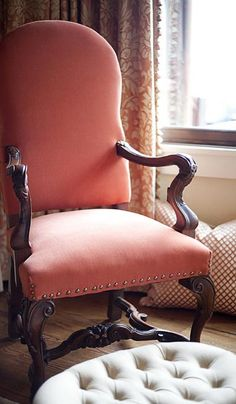 Coral & tan bedroom with velvet chair -- Francie Hargrove Interior Design