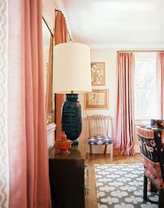 love the pink drapes and rug