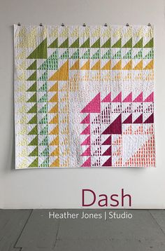 DASH QUILT PATTERN by Heather Jones Studio, 2 sizes Dash was inspired by a vintage quilt. It is a great project to play with color and value, plus a good opportunity to brush up on your piecing skills. The bold design works well with both solid and printed fabrics. This pattern is