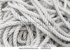 White marine rope in disorder; Disentanglement needed - stock photo