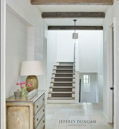White and bright hallway and staircase in a magnificent home by Jeffrey Dungan. Wood Plank Walls, Planked Walls, Wood Beams, Bright Hallway, Flagstone Flooring, Residential Architect, Entrance Foyer, Bright Homes, White Paneling