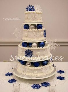 Winter Wonderland Wedding, use decorative Christmas balls between your layers in your wedding colors-add fresh flowers and greens