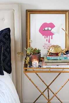 Repurpose a tray table as a nightstand. | 14 Clever Ways To Declutter And Decorate Using Trays