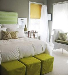 green and grey room - I like the chairs at the base of the bed