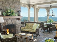 stone fireplace, stone patio, mountain view, {green+brown} and a killer light fixture. love!
