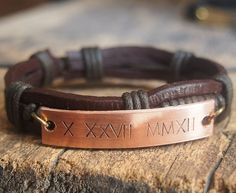 Mens bracelet, Mens personalized leather bracelet, Men's Leather Bracelet, Roman Numeral bracelet, Engraved Bracelet, Birthday bracelet by Stampedbracelet on Etsy https://www.etsy.com/listing/196911810/mens-bracelet-mens-personalized-leather